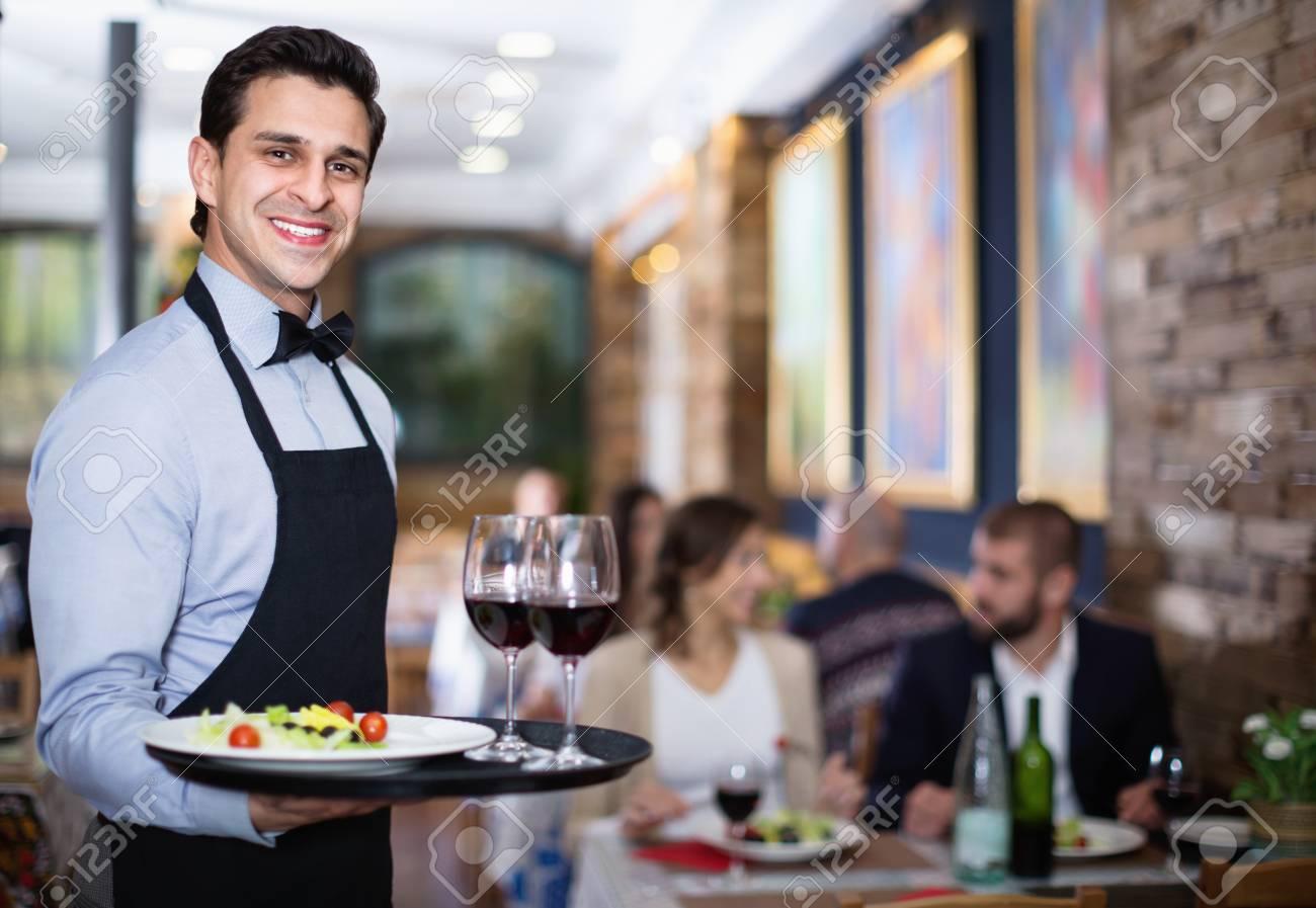 Professional Pleasant Waiter Holding Serving Tray For Restaurant Stock Photo Picture And Royalty Free Image Image 97329572