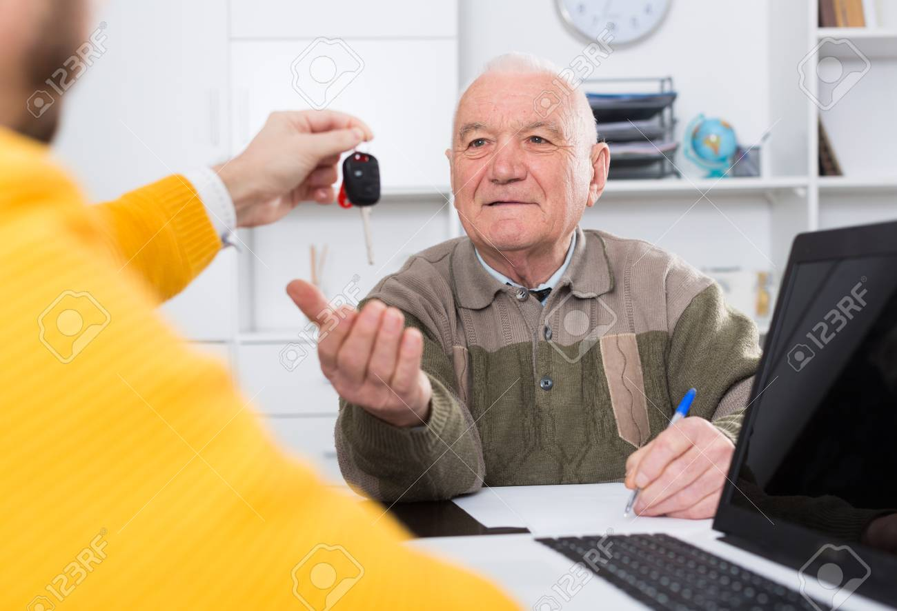 Old Man And Manager Signed Car Purchase Contract At Office And ...