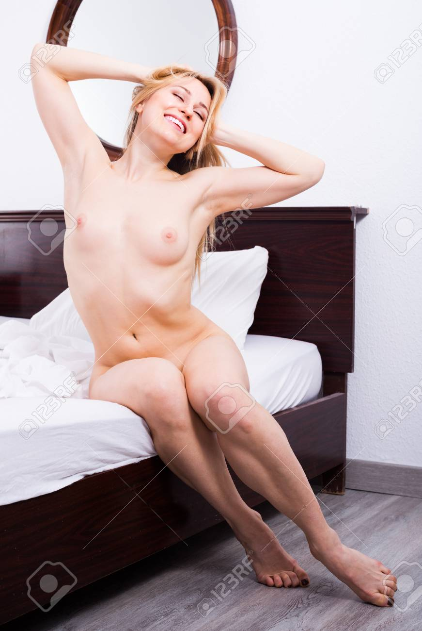 Young Woman Without Clothes Sitting On Bed In Bedroom Stock Photo Picture And Royalty Free Image Image 97821136