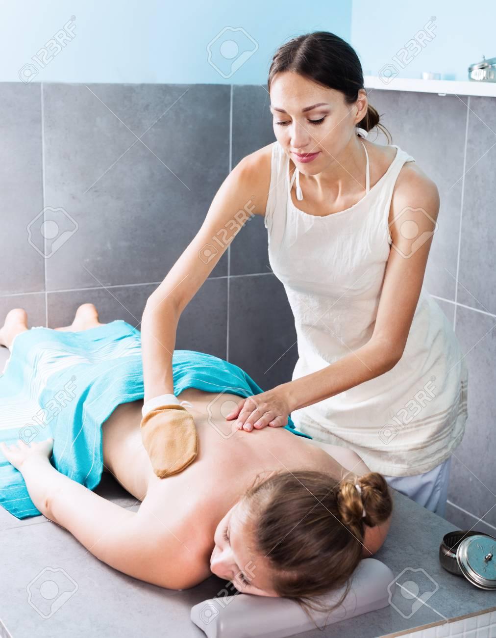 Female Massage Therapist Massaging Positive Woman Stock Photo 98016318