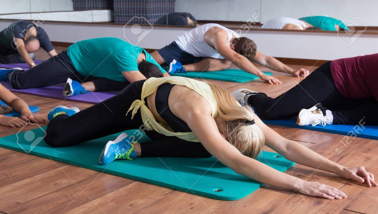 Men And Ladies Learning Yoga Positions Stock Photo Picture And Royalty Free Image Image 110886872