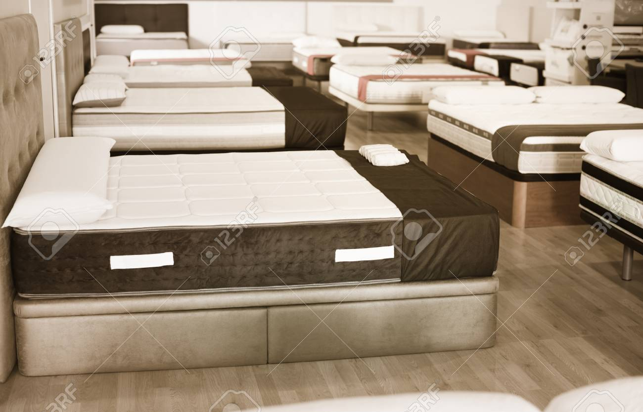 New Style Mattresses On The Beds In The Store. Stock Photo