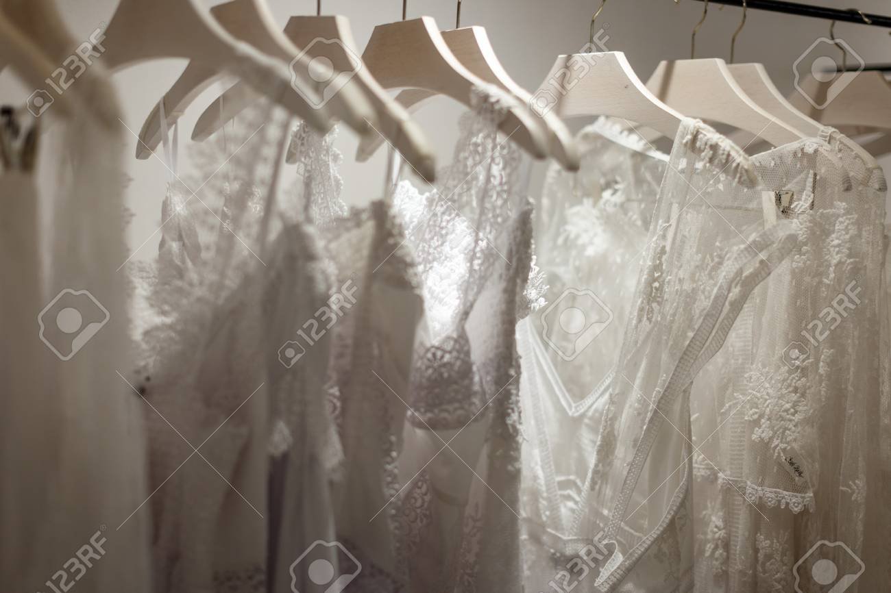 Wedding Dresses On Hangers In Wedding Salon Interior