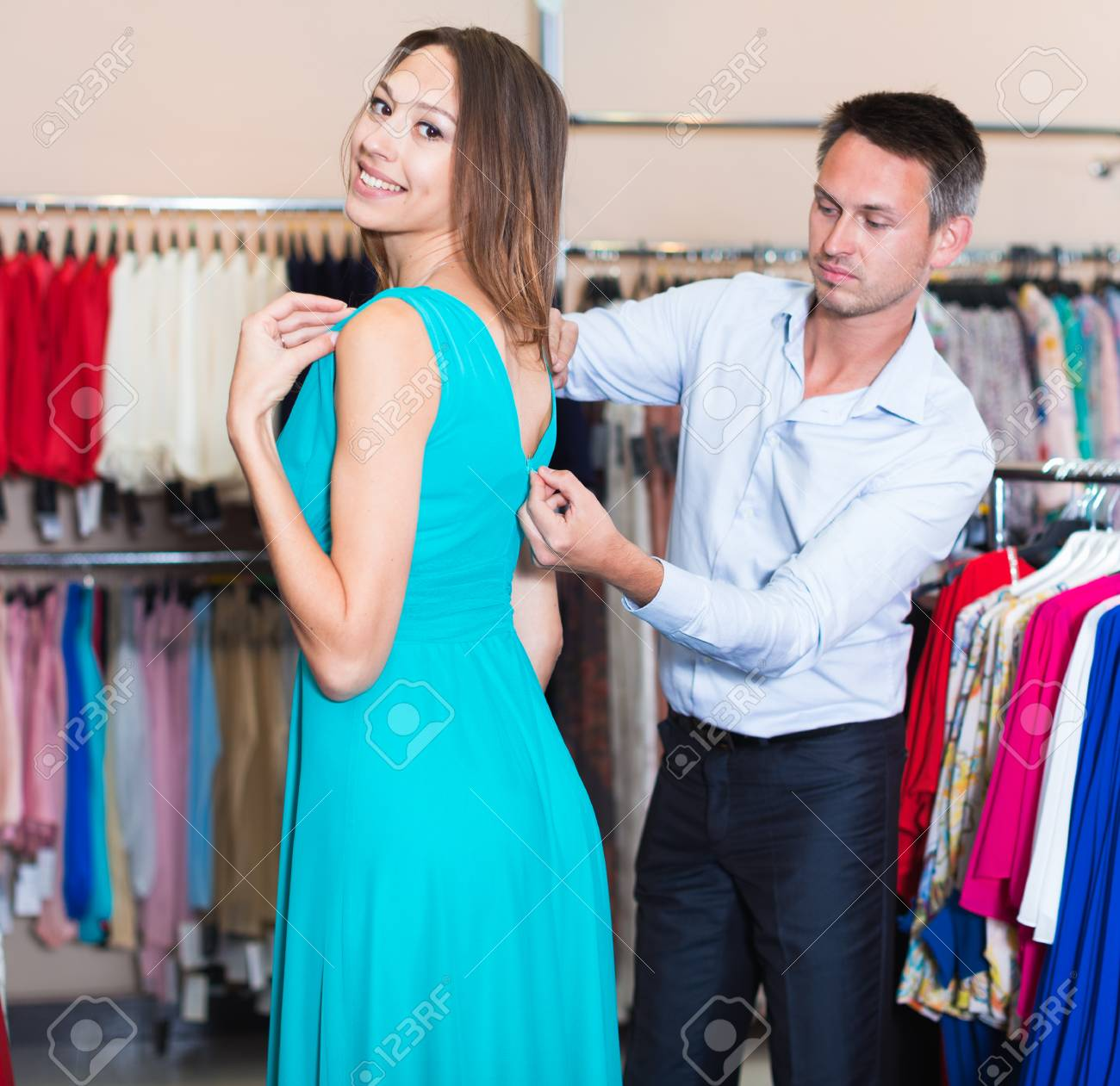 cf14f18e60 Portrait of family couple choosing new dress in women clothes shop Stock  Photo - 113845766
