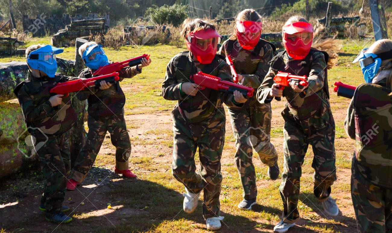 Two Opposing Teams Of Active Kids Shooting On Paintball Playing.. Stock Photo, Picture And Royalty Free Image. Image 114638466.