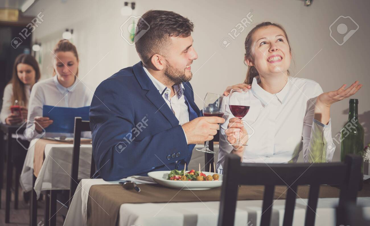 Elegant Female And Her Boyfriend Are Celebrating Date For Dinner Stock Photo Picture And Royalty Free Image Image 115618908