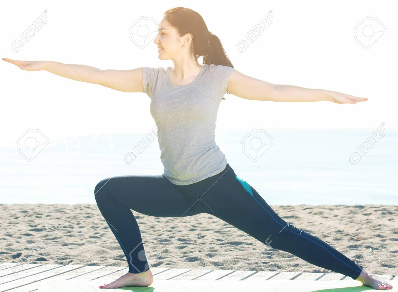 Young Spanish Woman Doing Yoga Poses On Sunny Beach By Ocean Stock Photo Picture And Royalty Free Image Image 121191375