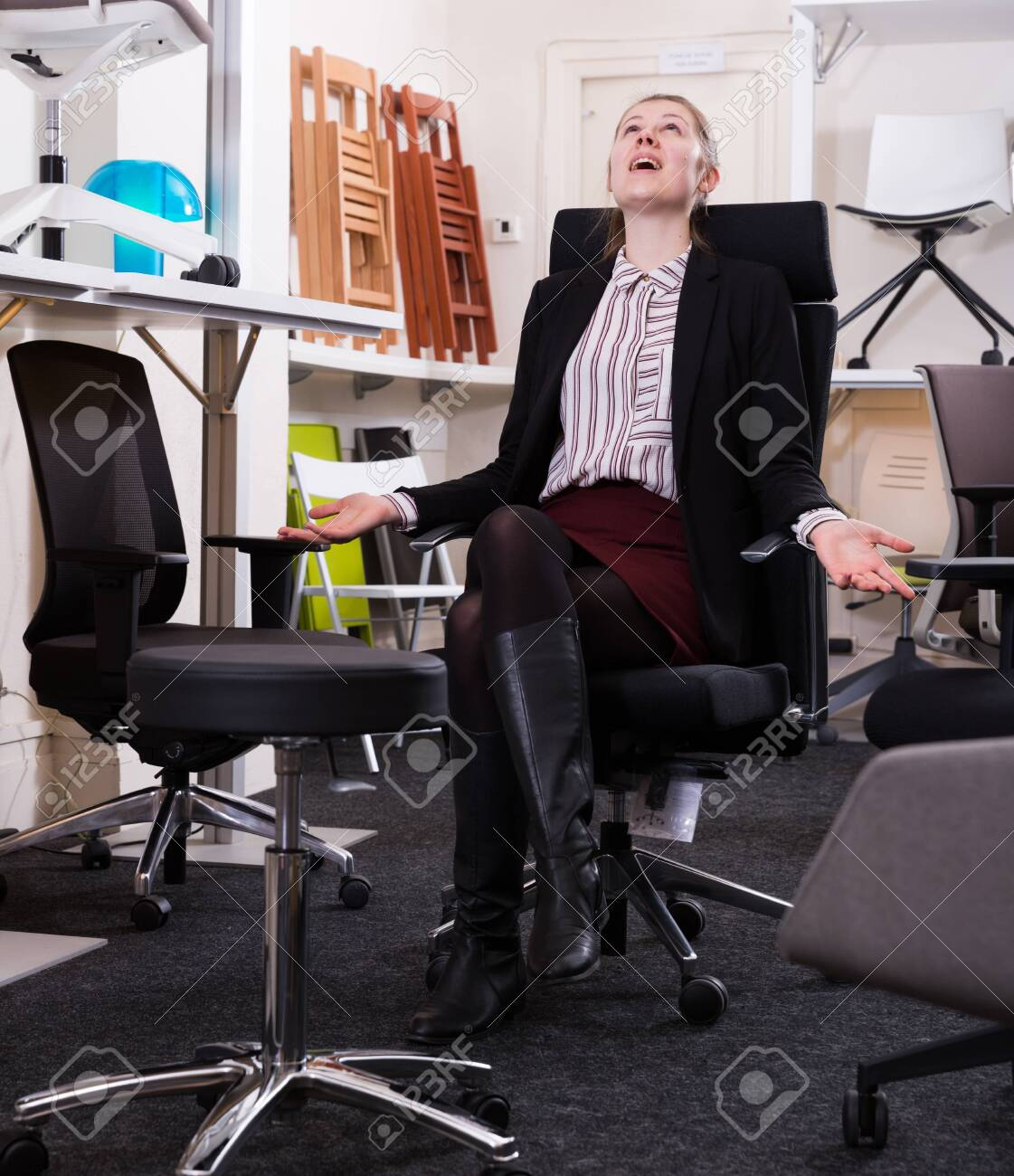 Satisfied Young Woman Sitting In Ergonomic Office Chair In Furniture Stock Photo Picture And Royalty Free Image Image 122624566