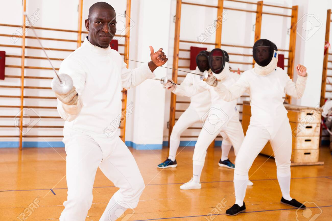 Sporty african american man fencer practicing effective fencing
