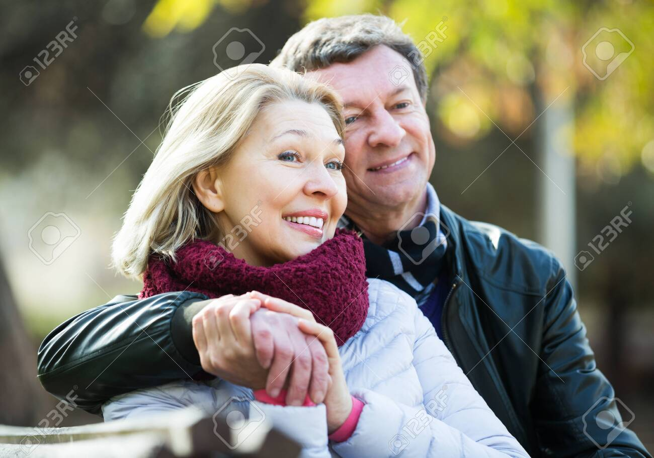 Portrait of happy senior couple spending time outdoors and enjoying together - 131895642