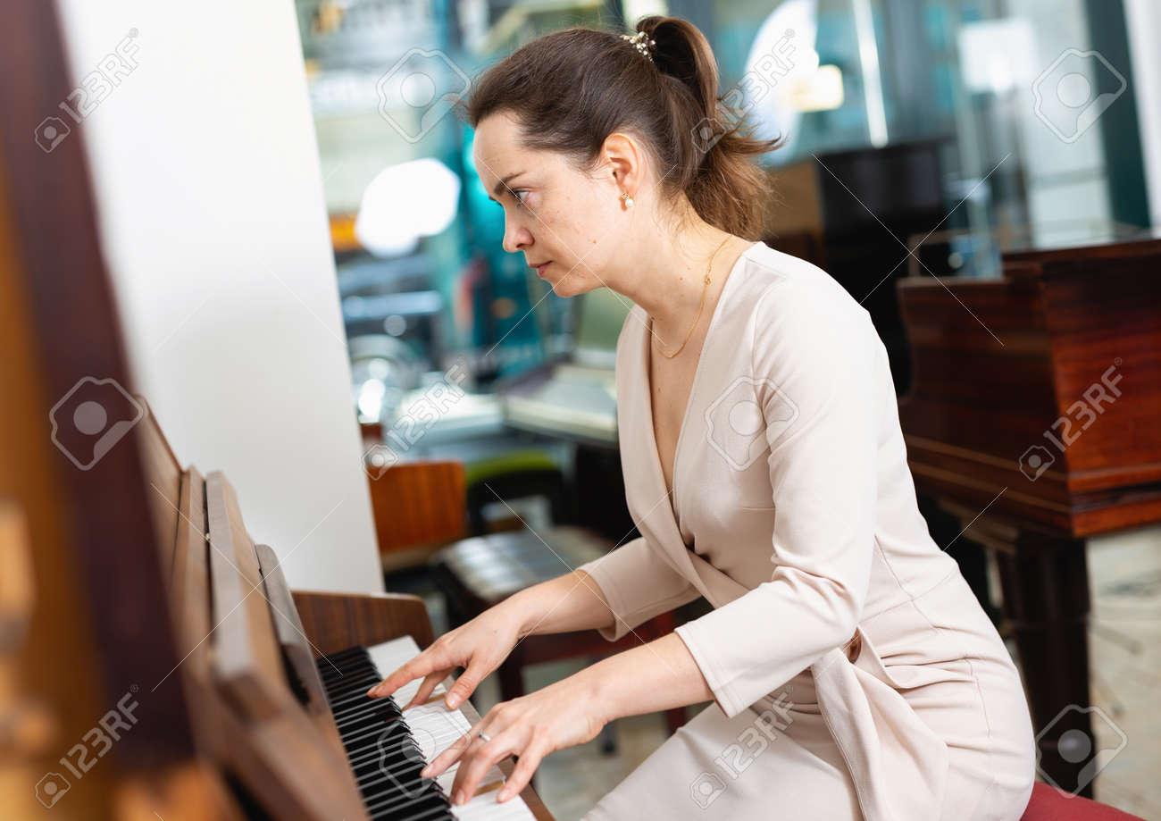 Portrait beautiful woman playing piano - 151847931