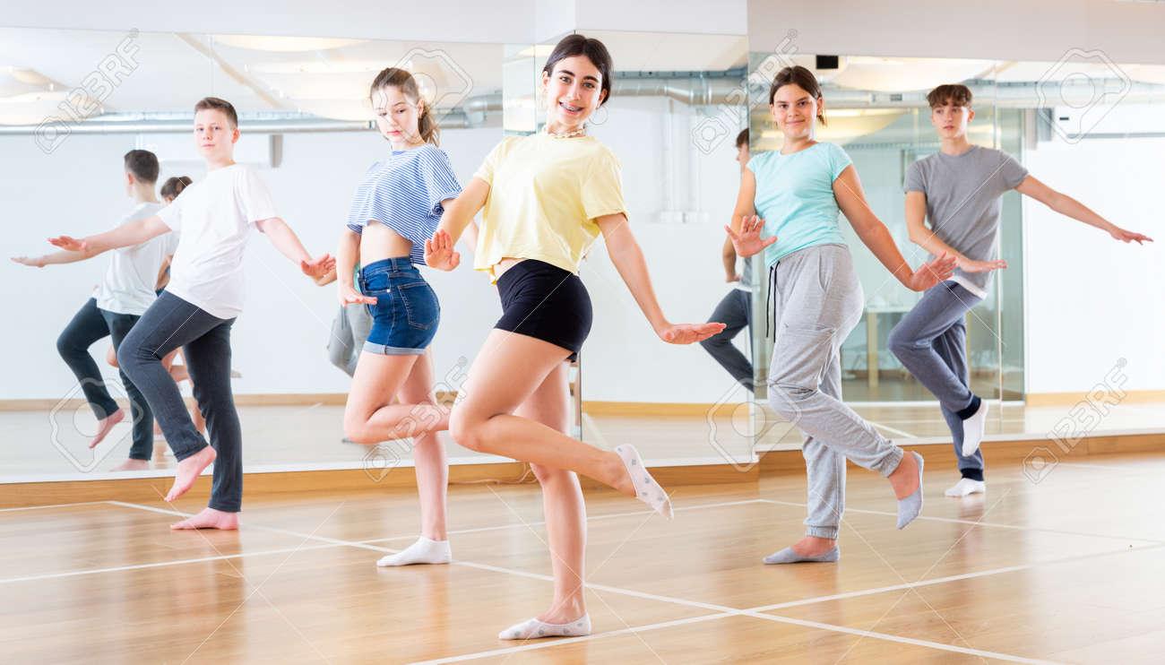 Teenage dancers practicing new dance in studio - 152261683