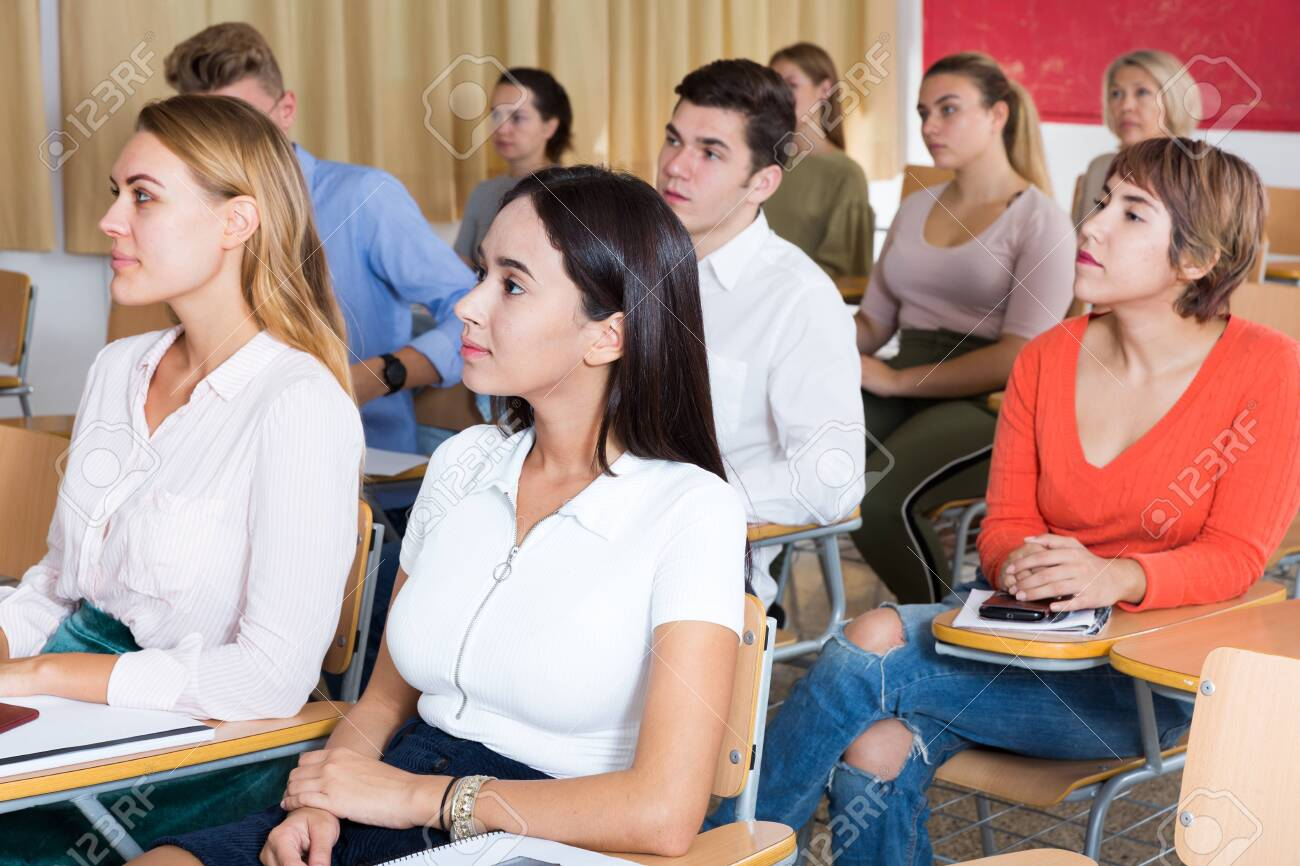 Young woman on lecture in classroom - 154037363