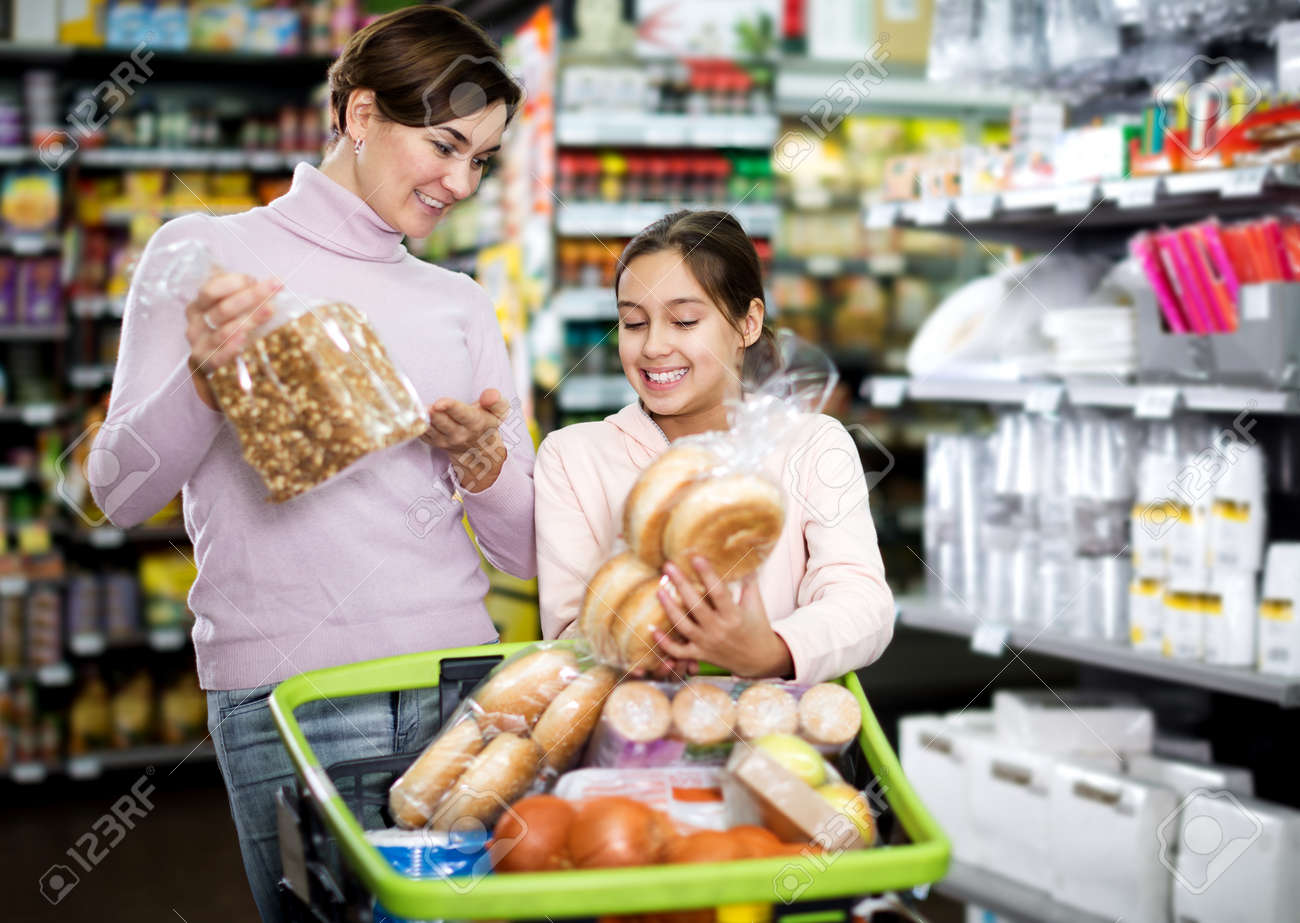 Woman with teenage daughter searching for bread - 156120757