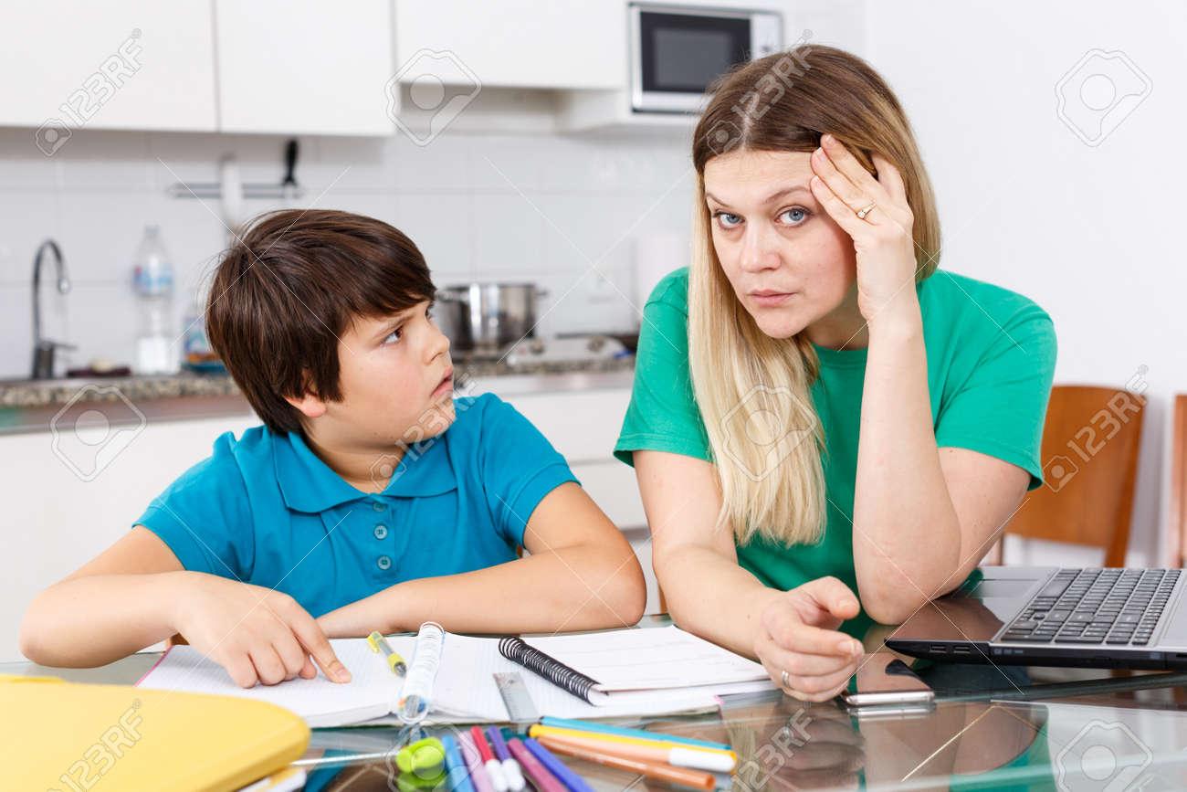Displeased family doing homework - 157399832