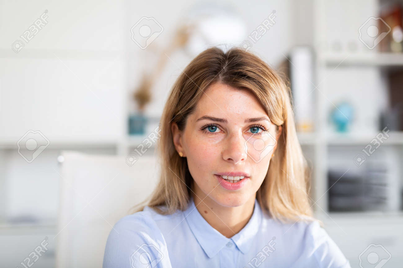 optimistic adult female person posing in white office - 158666449