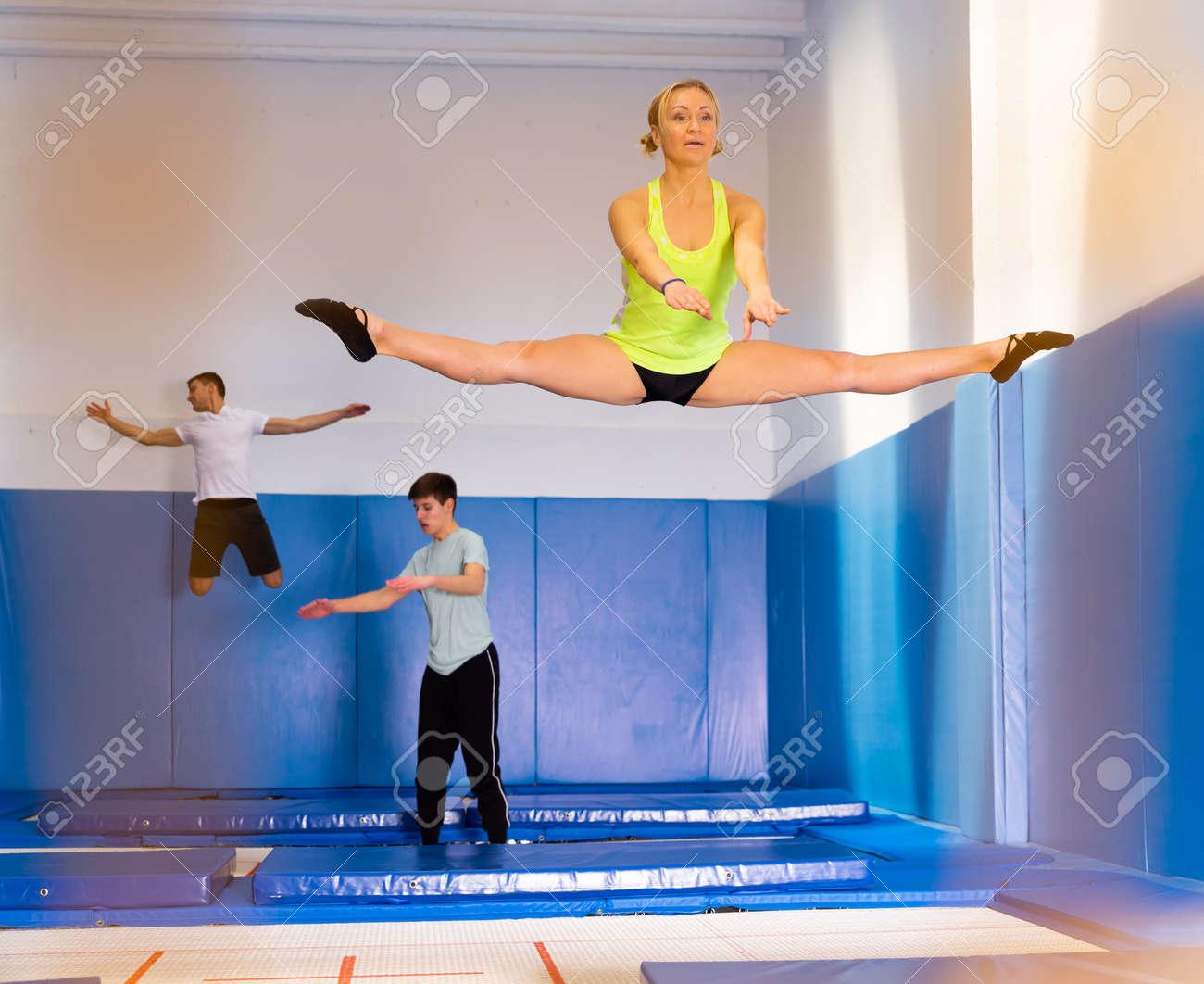 Woman training in trampoline center - 158714085