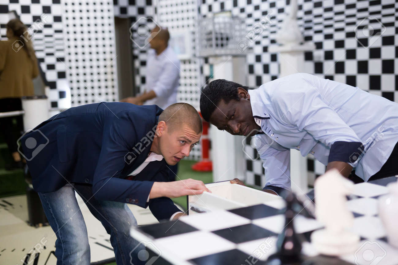 Four friends looking for way out of chess quest room - 163577066