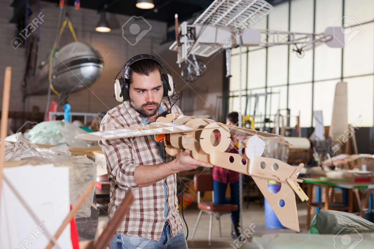 Male creating airplane models - 167126033
