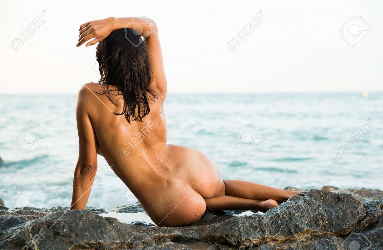 Nude woman sitting gracefully on rock - 167530752