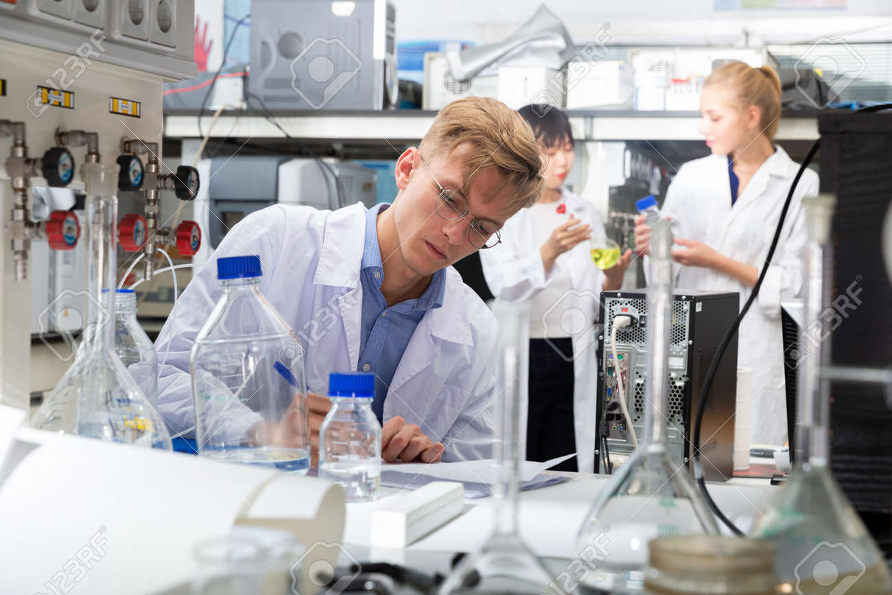 Male scientist working at biochemical laboratory - 168116728