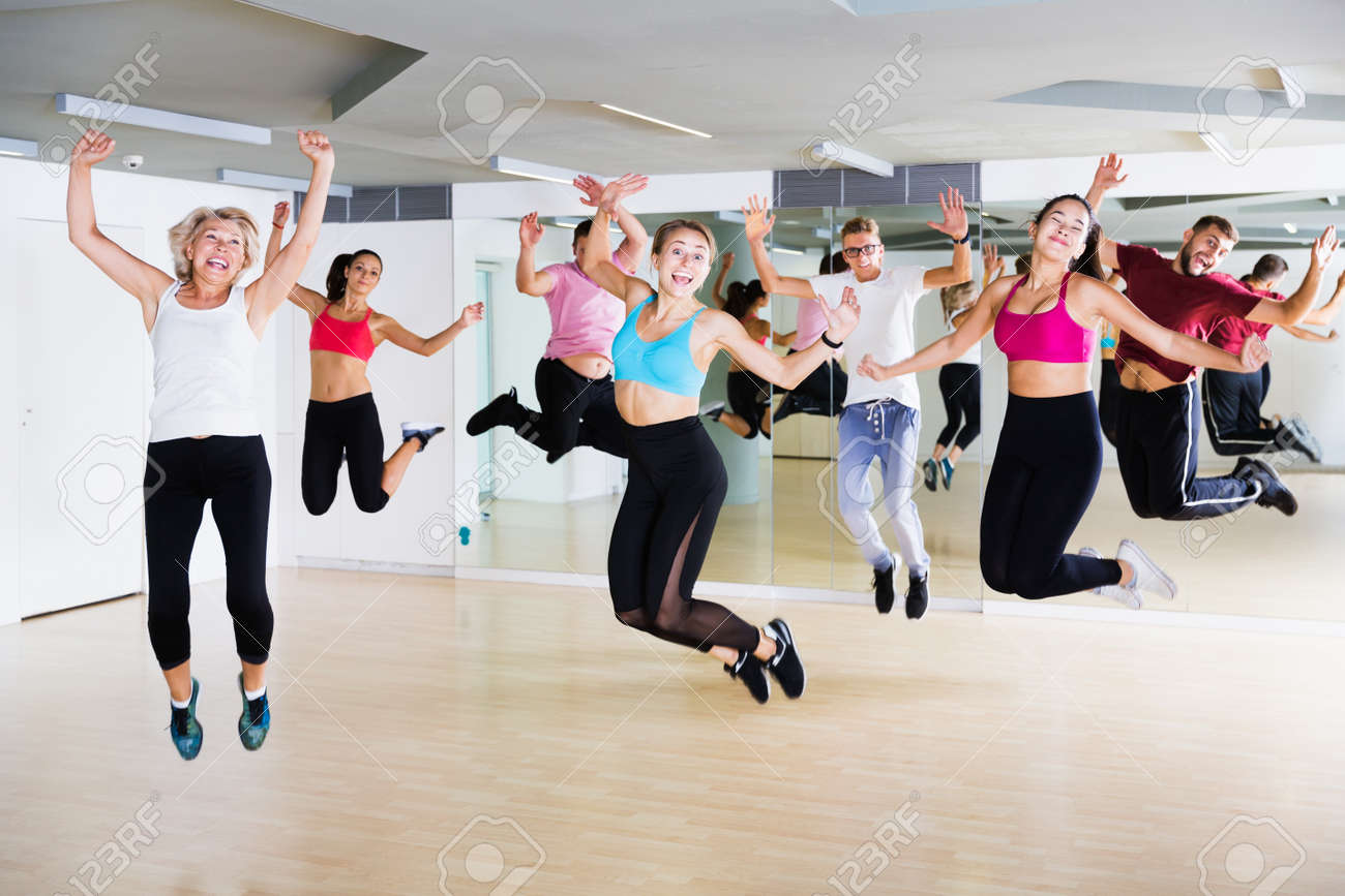 Adults jumping at dance class - 168724970