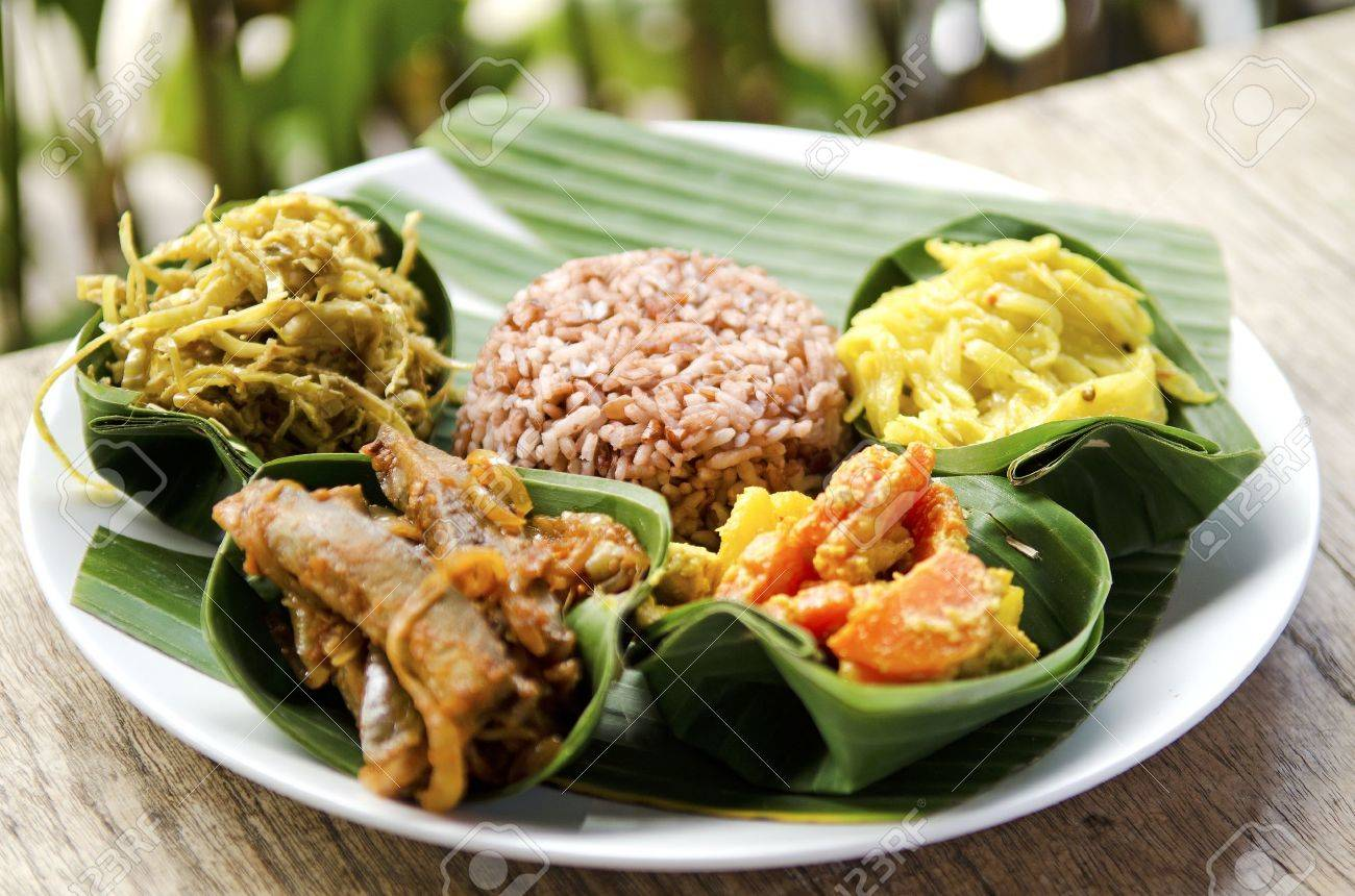 indonesian food in bali, several curries and rice stock photo