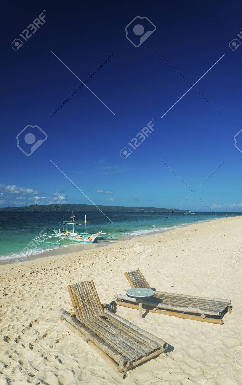 Outstanding Lounge Chairs And Traditional Boat On Puka Beach In Tropical Creativecarmelina Interior Chair Design Creativecarmelinacom