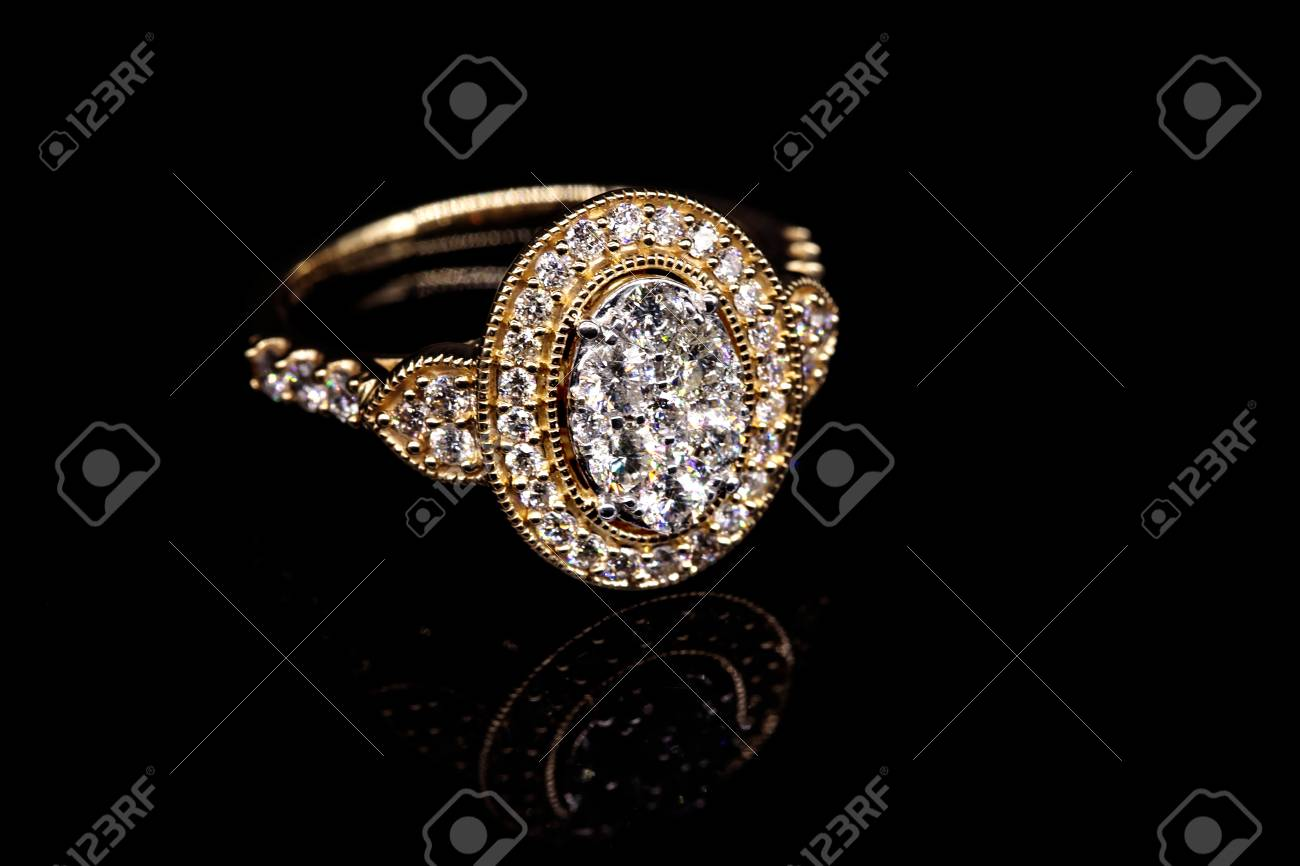 A Stylish And Elegant Halo Style Diamond Cocktail Ring Set In