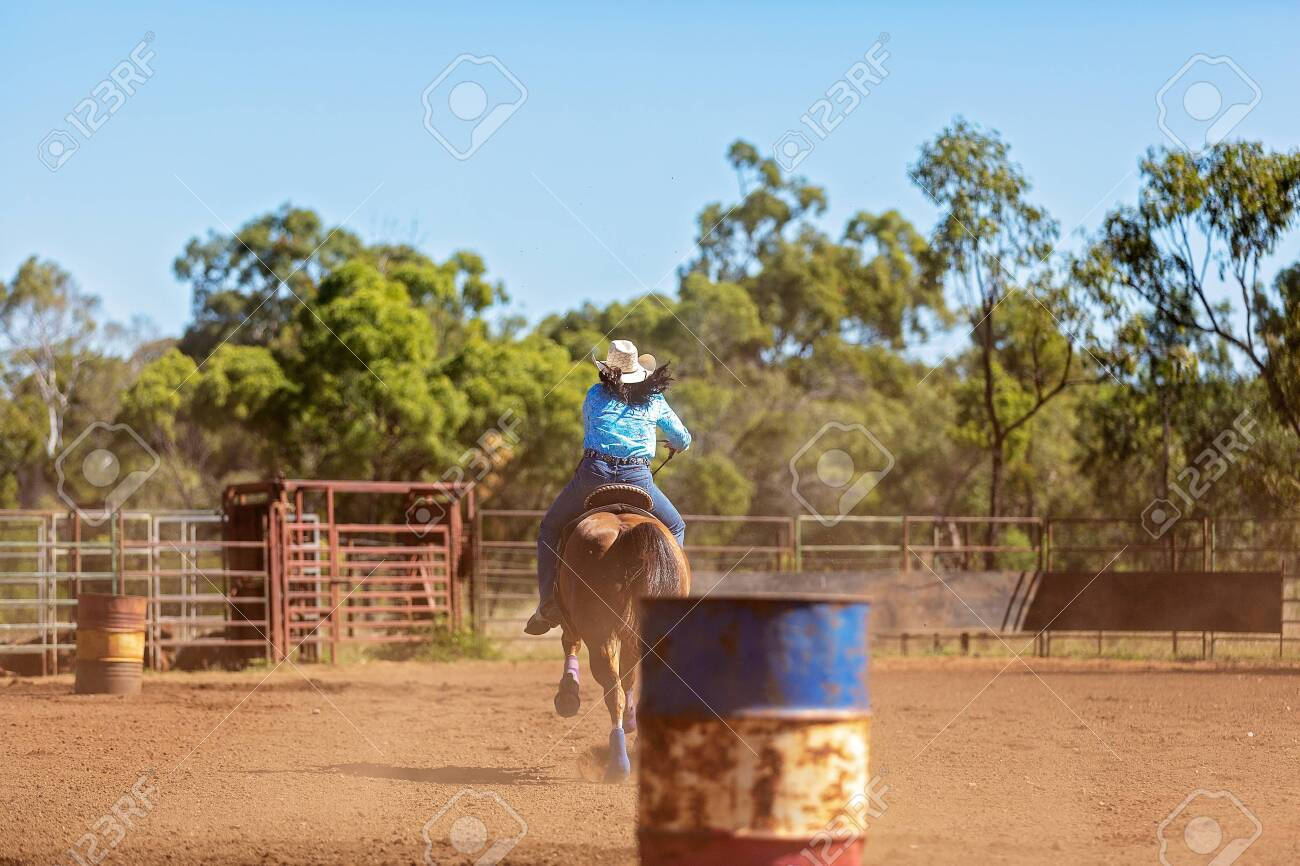 Female Equestrian Competing In Barrel Racing In Dusty Arena At Stock Photo Picture And Royalty Free Image Image 128283610