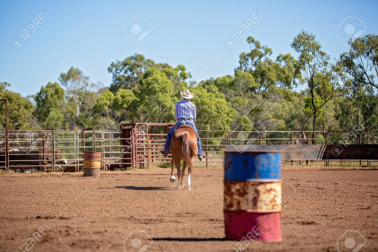 Female Equestrian Competing In Barrel Racing In Dusty Arena At Stock Photo Picture And Royalty Free Image Image 128283690