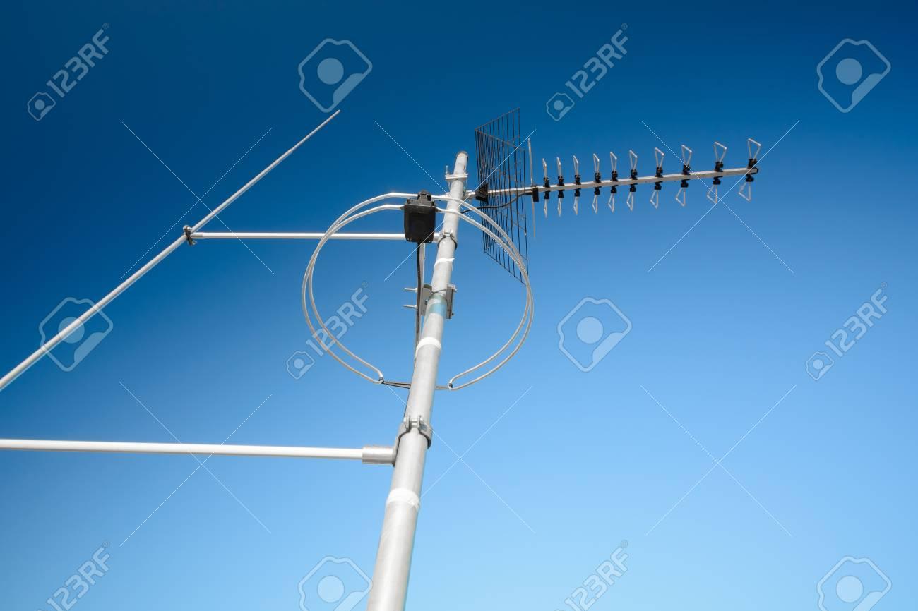 simple antenna mast with antennas to receive digital TV and radio