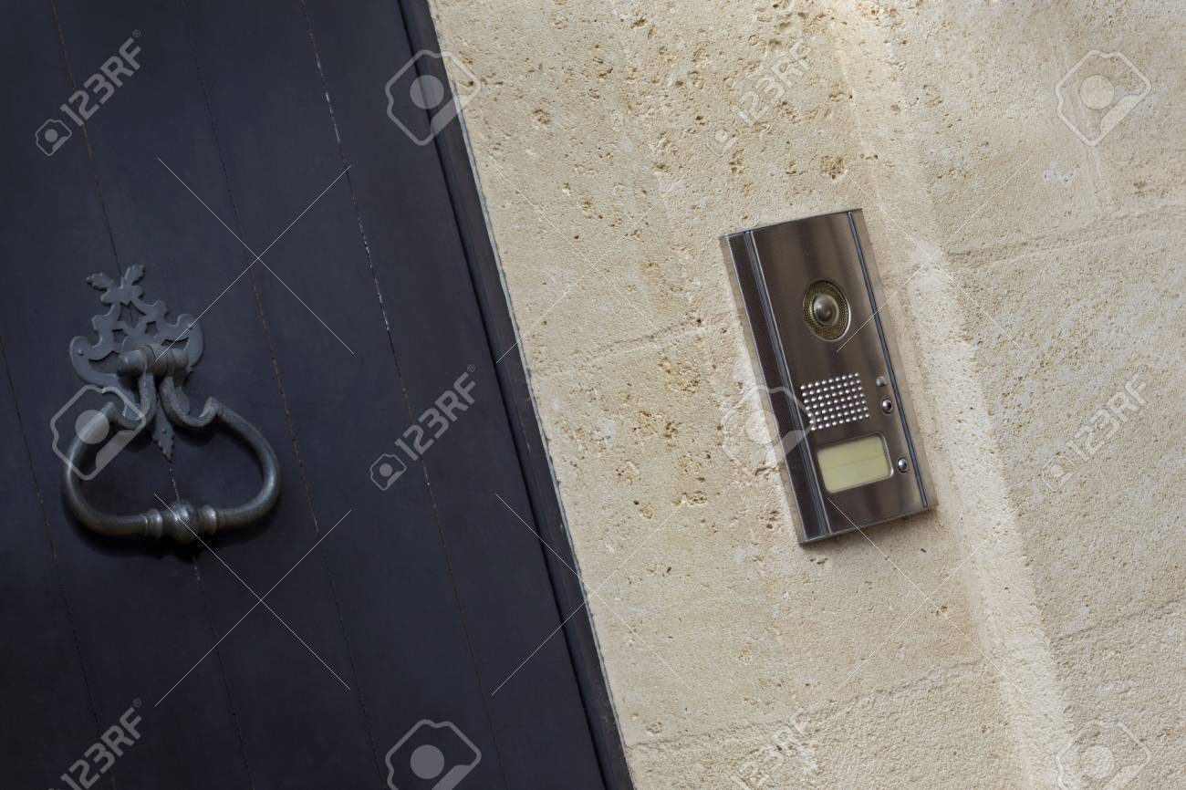 Modern Intercom And Classic Door Knocker On The Facade Of A French Mansion  Stock Photo