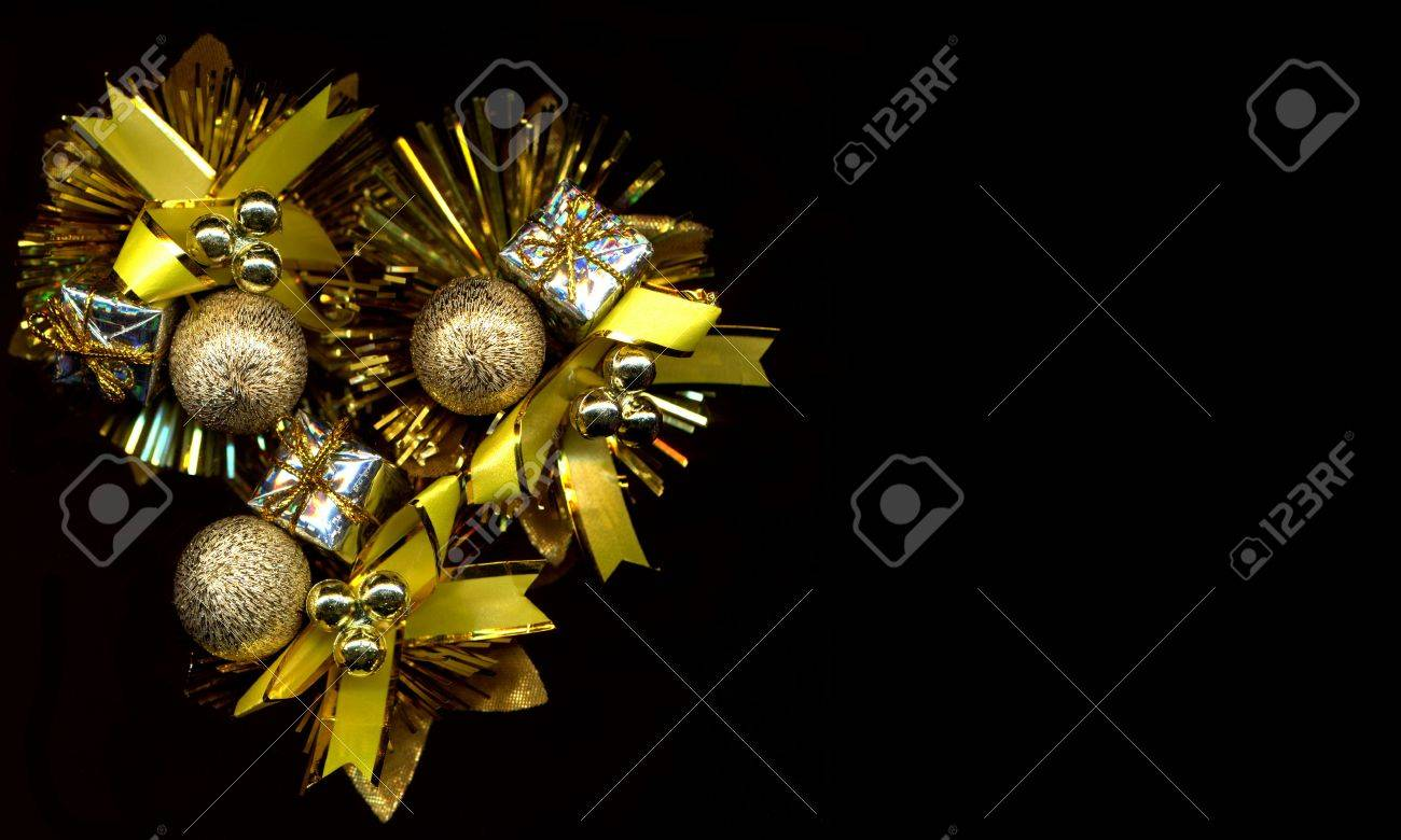 Black and gold christmas decorations - Gold Christmas Decorations On Black Background Stock Photo 5777781