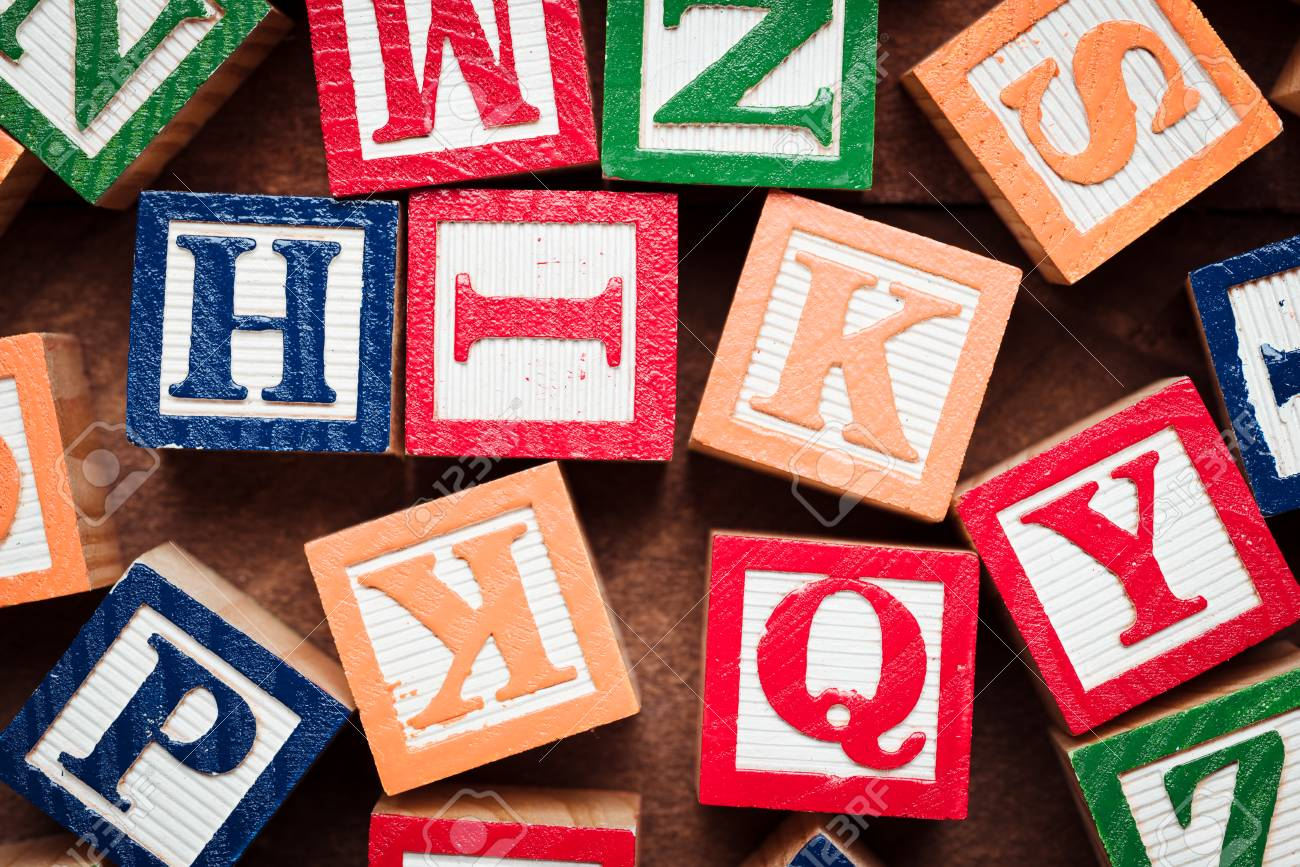 multi colored wooden letter blocks on natura wood background stock photo 101758412