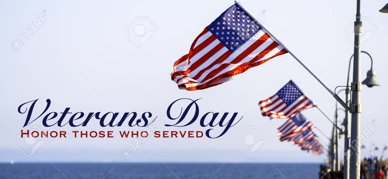American Flags With A Veterans Day Greeting With Blue Sky Background