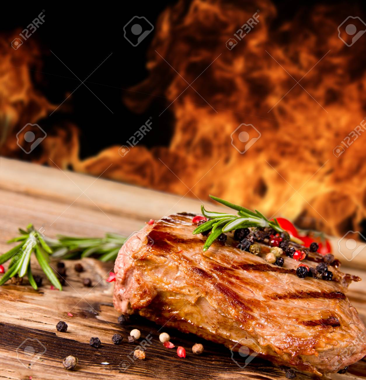 Grilled beef steak with flames on background Stock Photo - 14389898