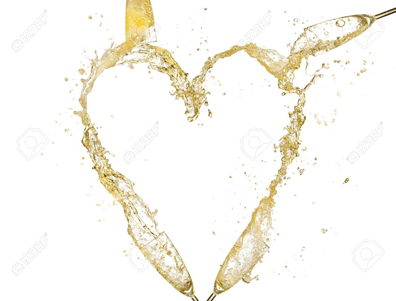 0617957268e2 Concept of heart symbol made of splashing champagne from glasses Isolated  on white background Stock Photo