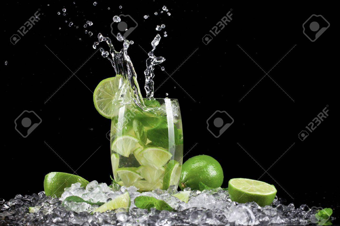 Mojito drink wish splash, isolated on black background Stock Photo - 17901111