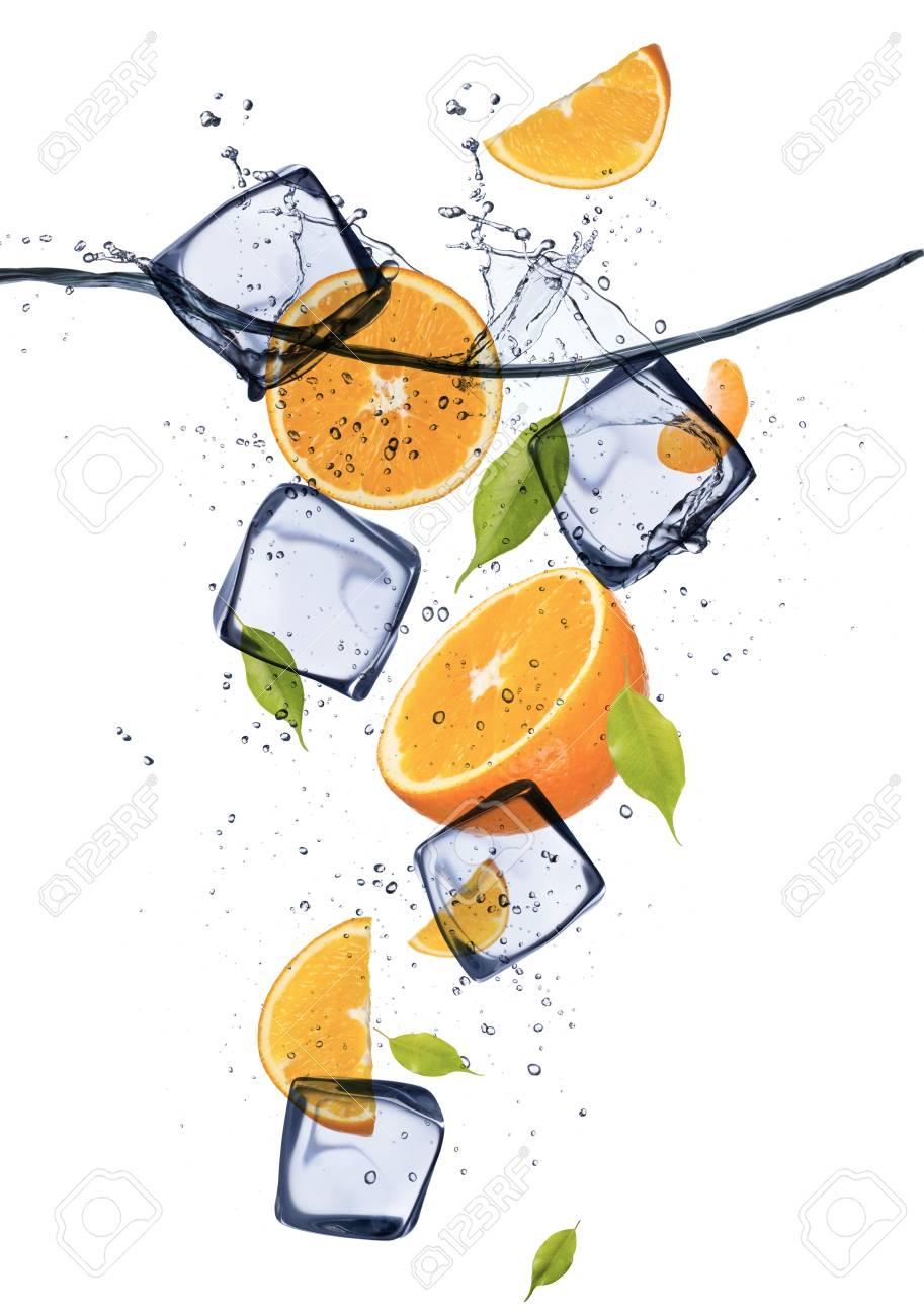 Oranges with ice cubes, isolated on white background Stock Photo - 18011362