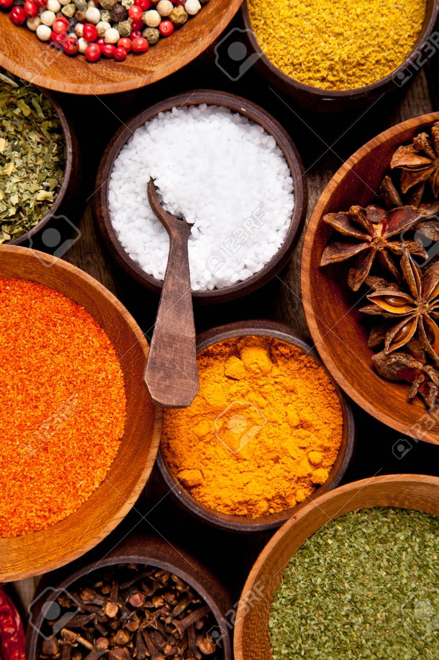 Various kind of spices in wooden bowls Stock Photo - 18215323