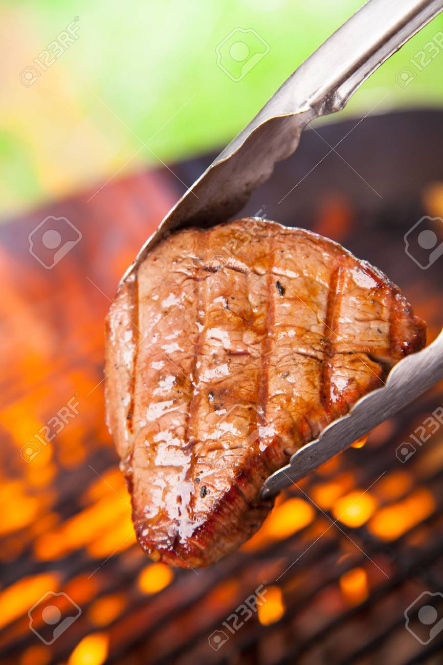Delicious beef steaks on grill Stock Photo - 21187805