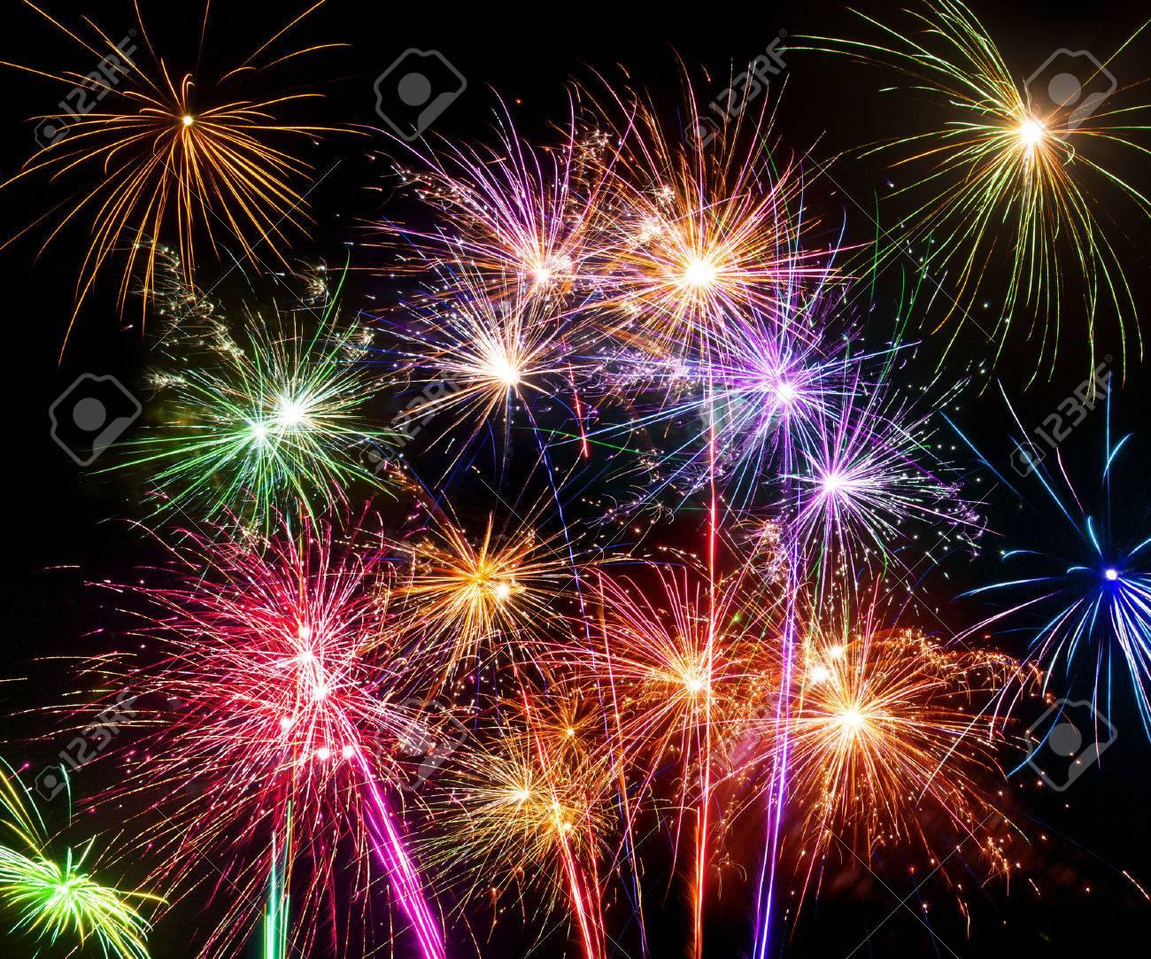 Isolated shots of fireworks blasts on black background - 23955877