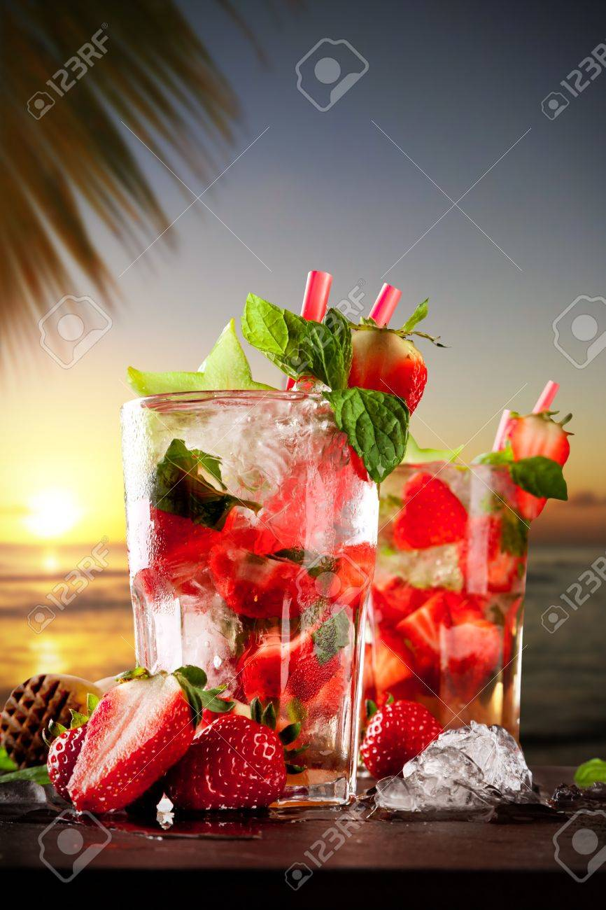 Mojito drinks on stone with evening blur ocean shore background Stock Photo - 27584726