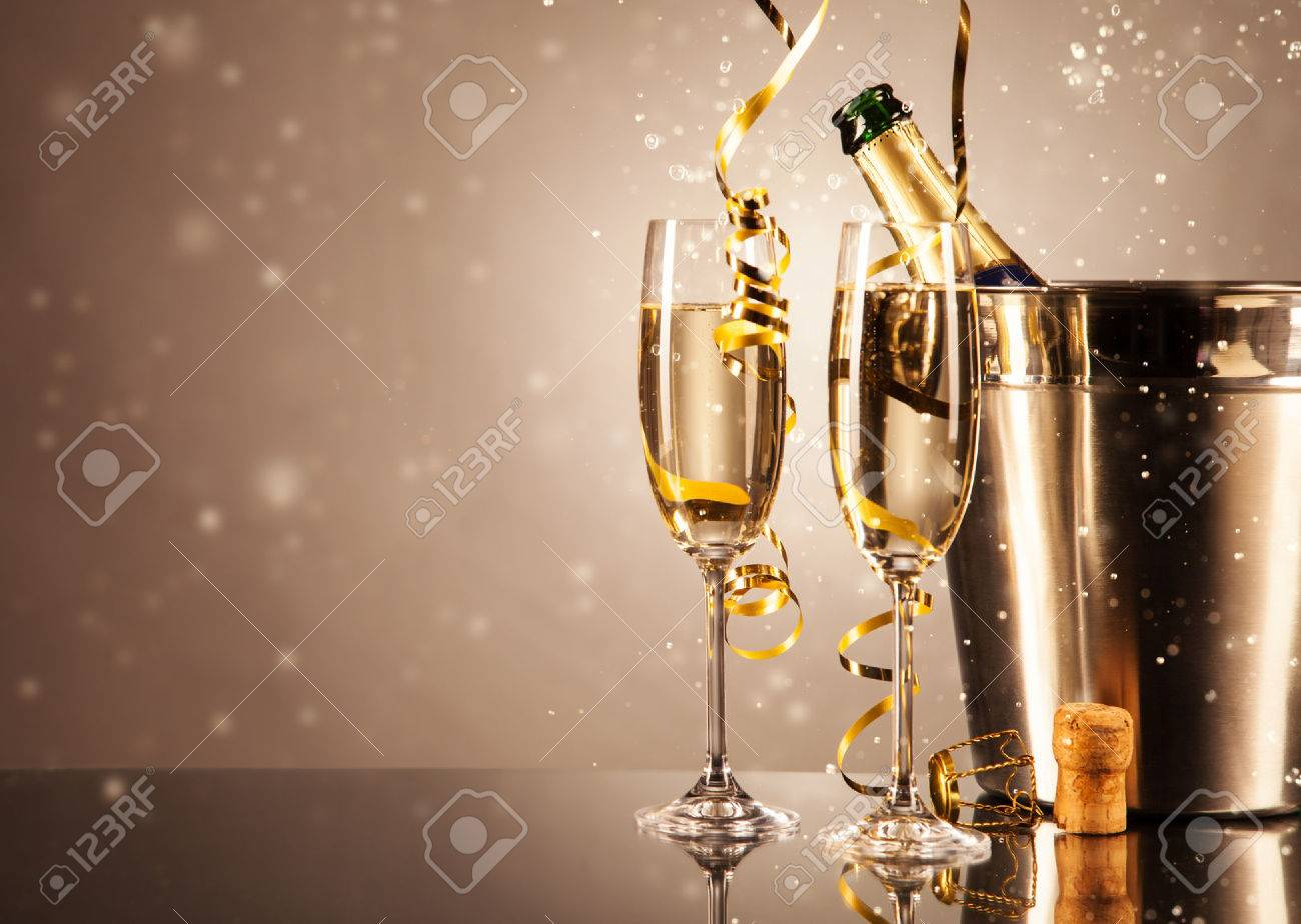 Glasses of champagne with ribbons and bubbles around. Concept of celebration Stock Photo - 33012689