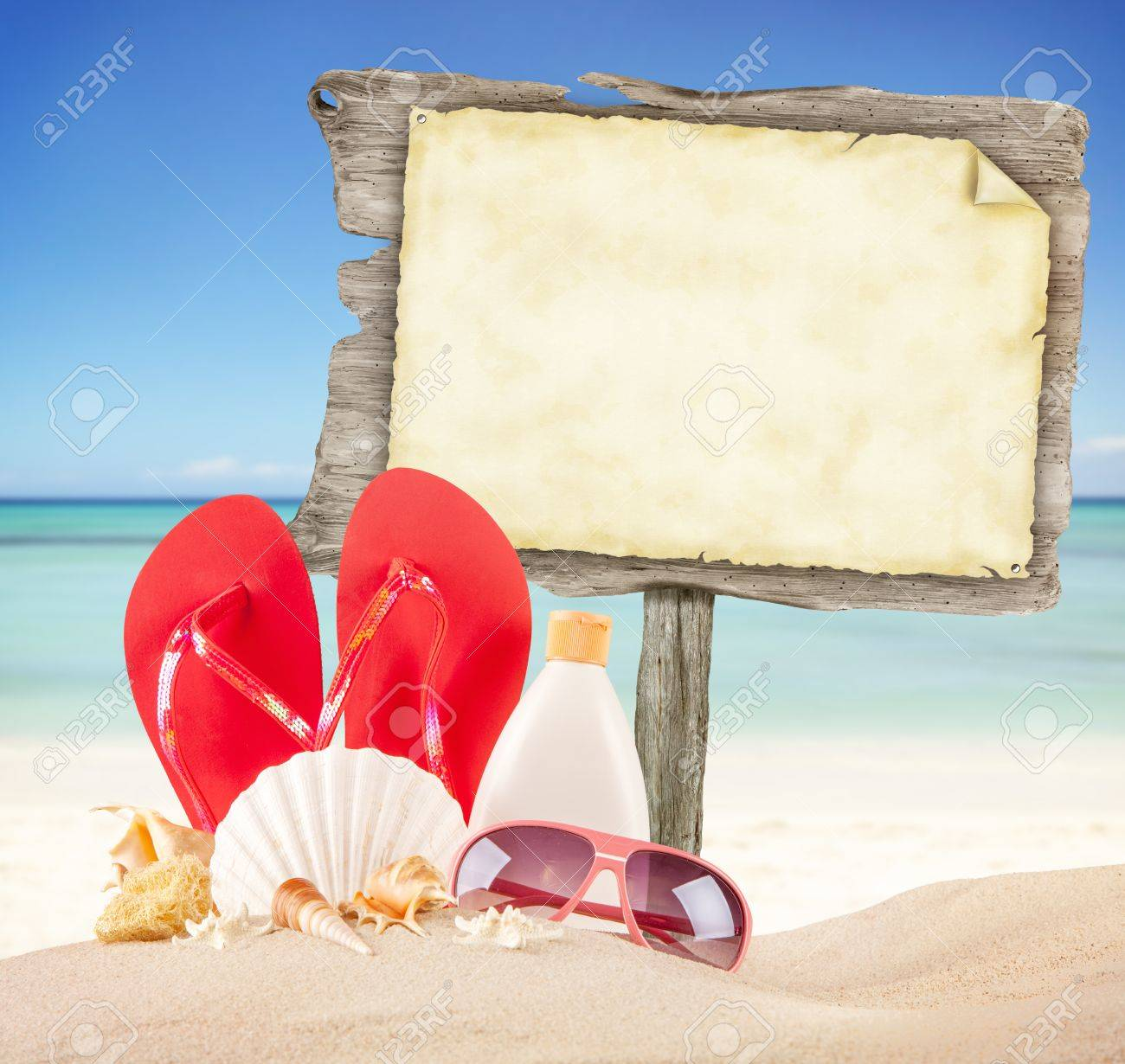 Summer Beach With Accessories And Blank Wooden Poster Blur Azure