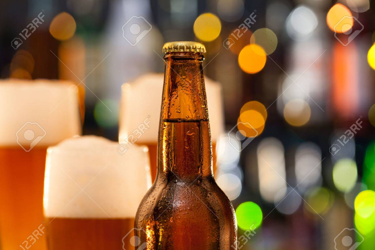 bottle of beer with blur jugs on background stock photo picture and