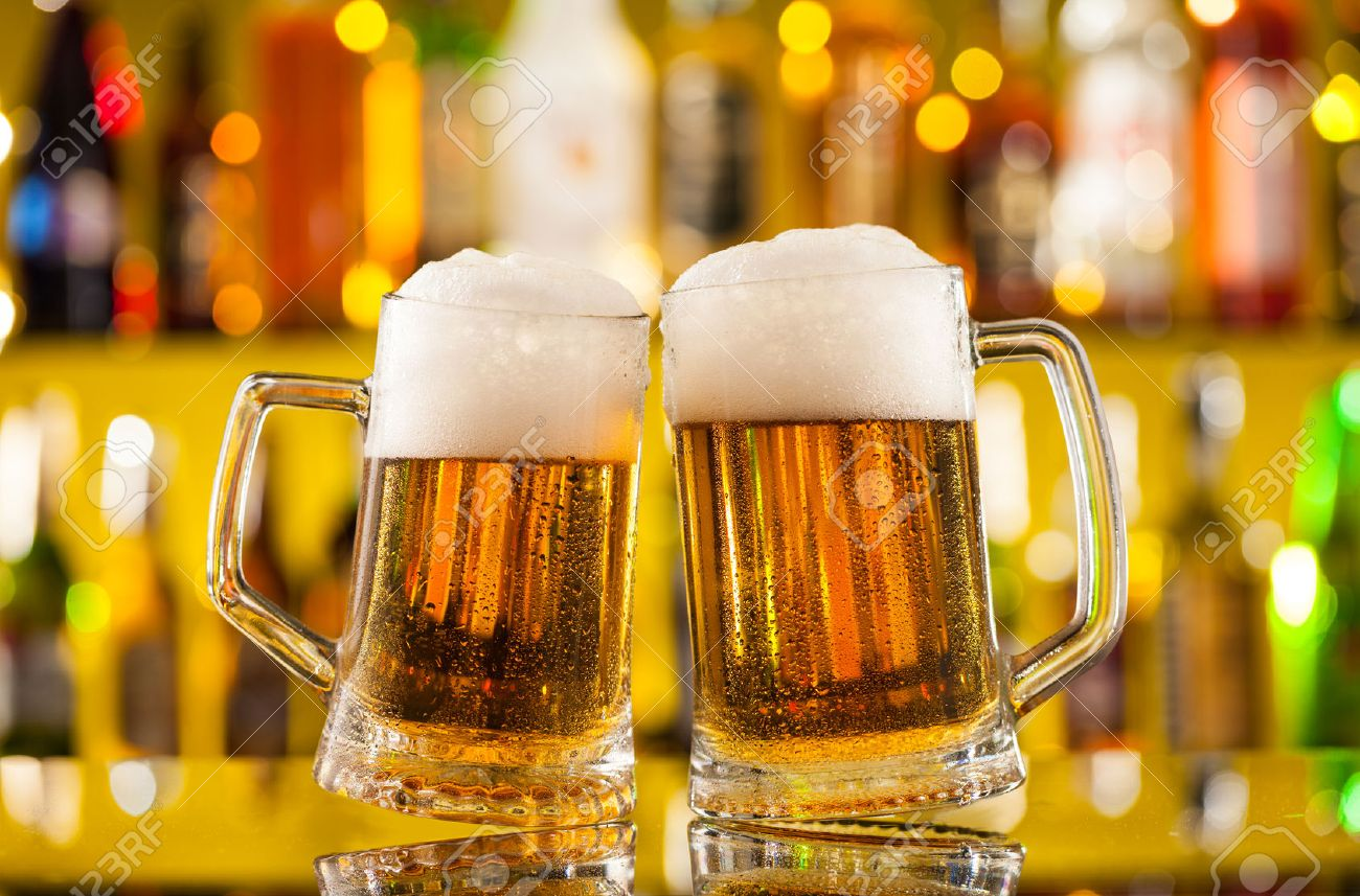 jugs of beer placed on bar counter with copyspace stock photo