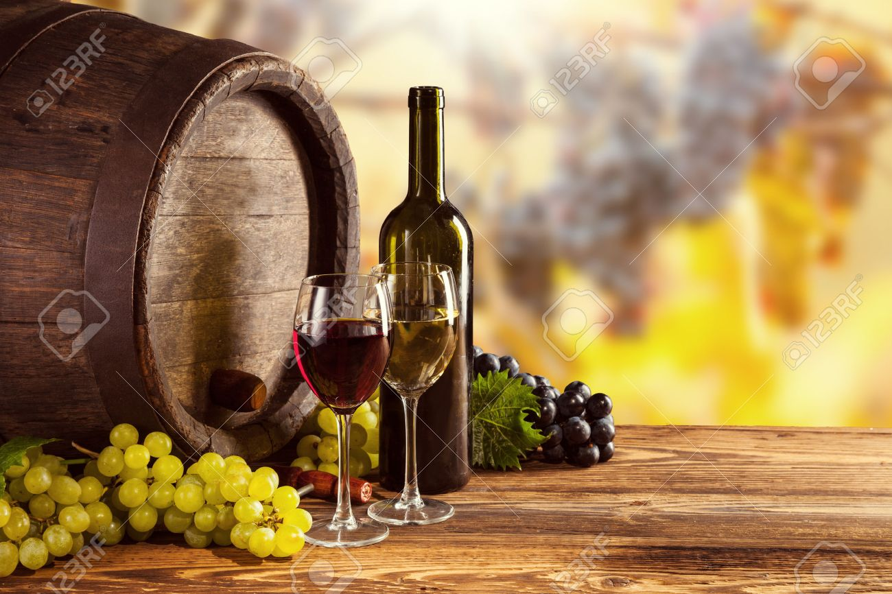 Red and white wine bottle and glass on wooden keg. Grapes of wine on background - 46446668