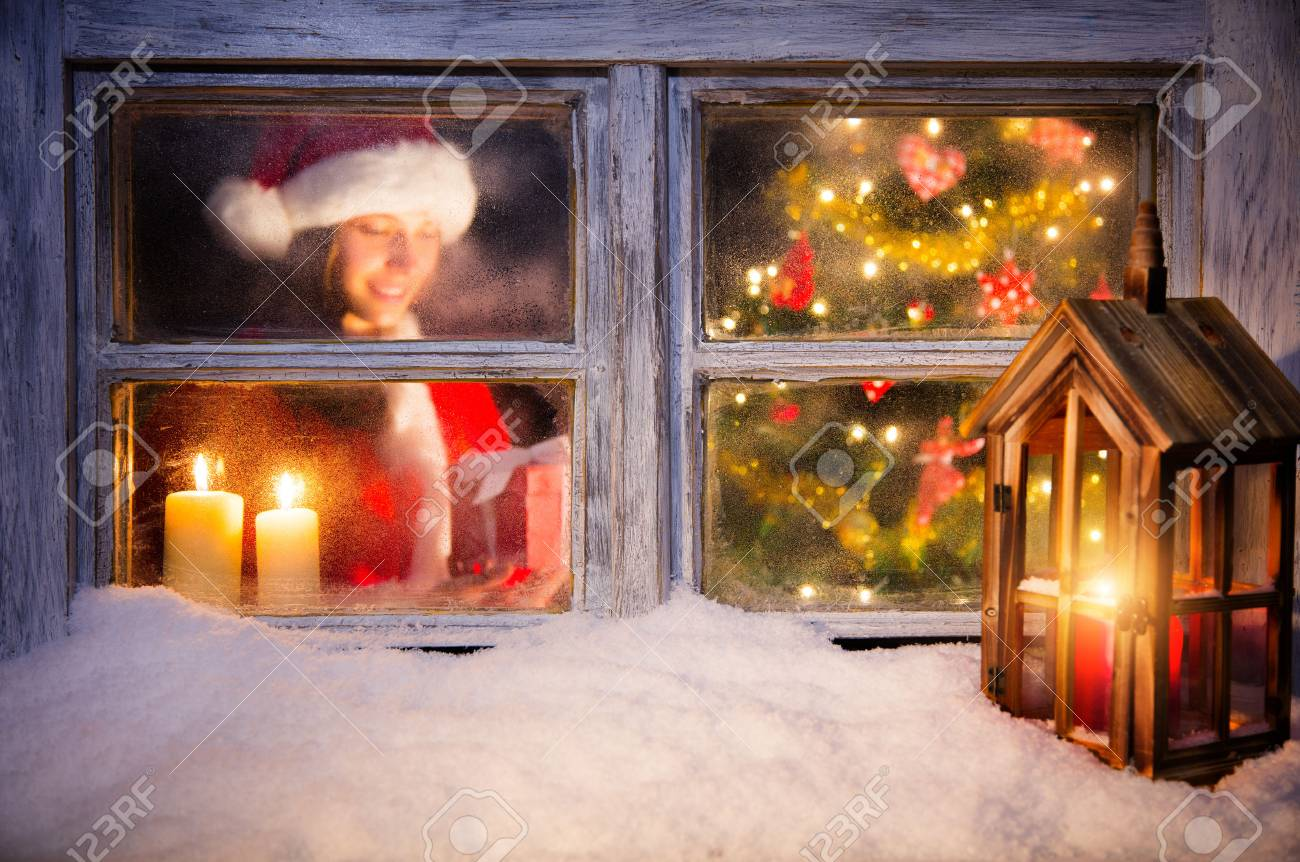 Christmas Window.Atmospheric Christmas Window With Santa Girl Holding Gift Next